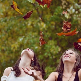 girls and fall leaves